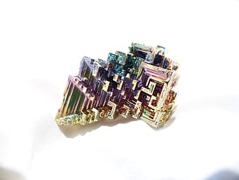 Iridescent accessory on white surface