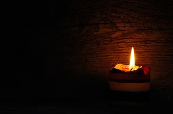 Low-light photography of candle