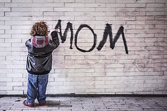 Photo of child spraying wall with mom text