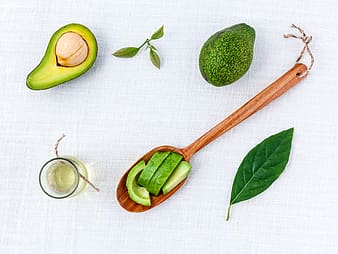 Sliced avocado and ladle