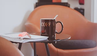Black mug on side table