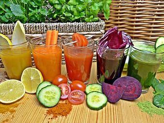 Assorted fruit juices on clear drinking glasses