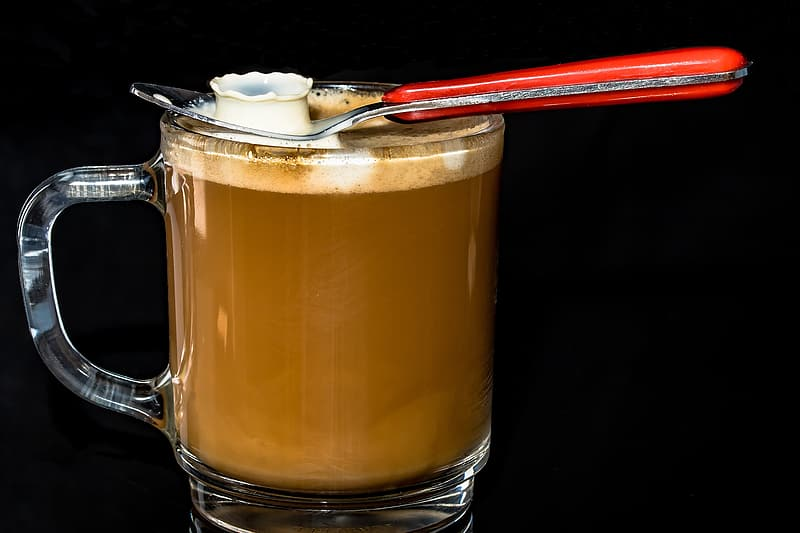 Clear glass mug with latte