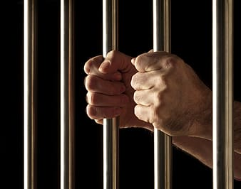 Person holding on bars