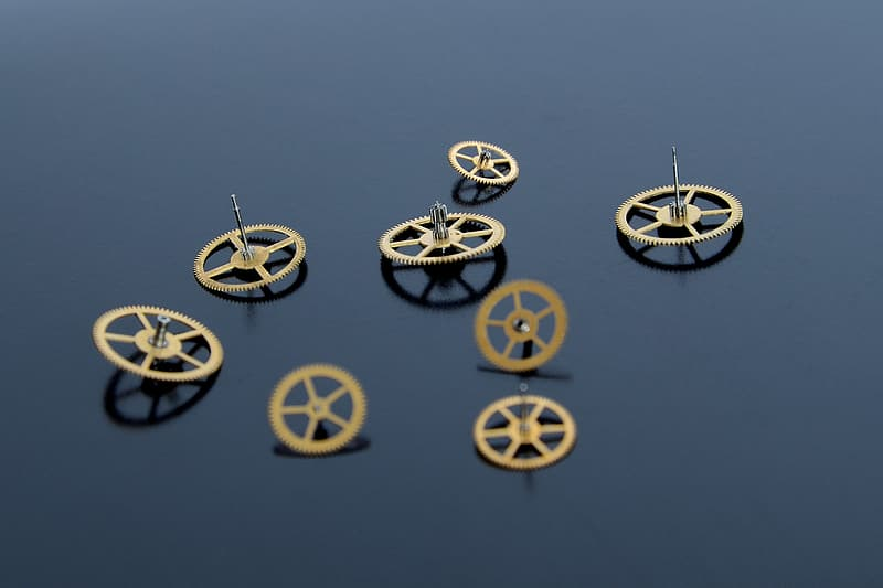 Round bronze-colored metal components