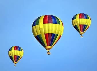 Three multicolored balloons