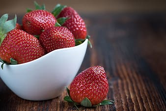 Strawberries in bowl on furniture