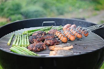 Grilled meat on black round plate