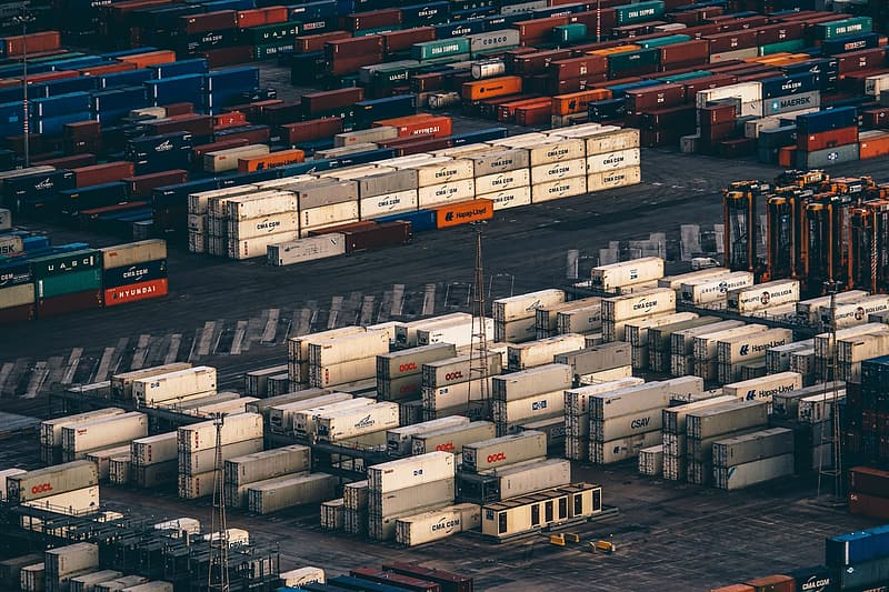 Pile of white and gray shipping containers at daytime