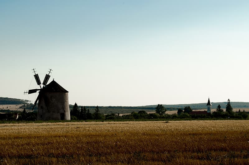 White and brown windmill during daytime