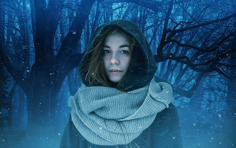 Woman standing near trees during winter