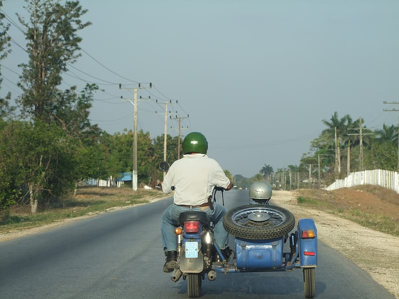 Man riding on tricycle