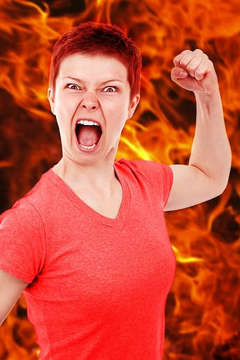 Woman in red v-neck top with flame background