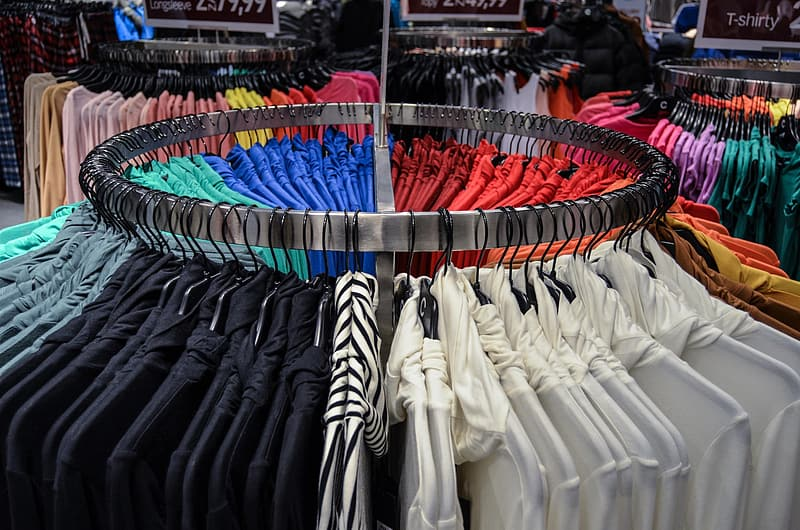 Assorted-color clothes on steel rack