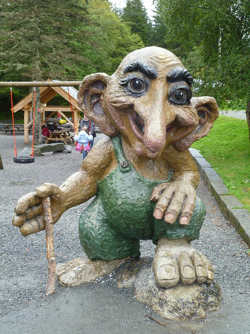 Green and brown monster statue