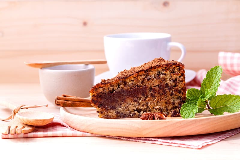 Shallow focus photography of slice of cake with mint leaves