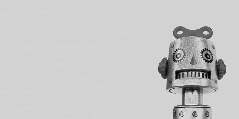 Grayscale photo of robot