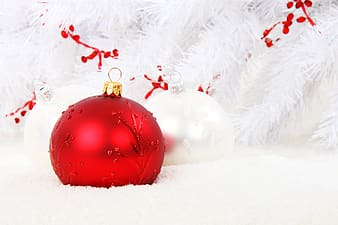Two white and red baubles