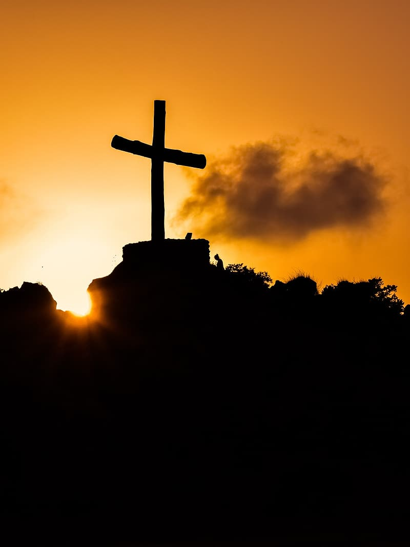 Silhouette of cross during sunset