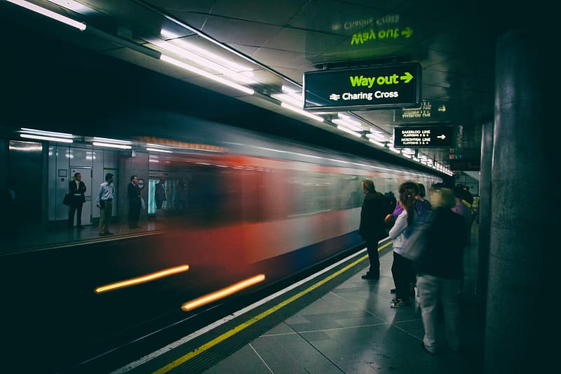 A train arrives for the waiting passengers on the platform of the London Underground network