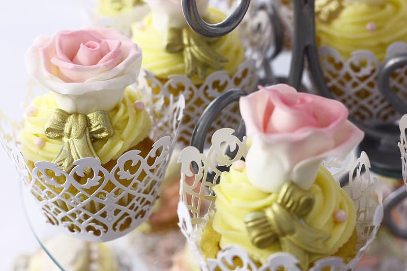 Pink and white rose themed cupcakes close-up photography