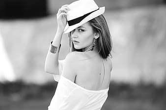 Grayscale photo of woman wearing white hat