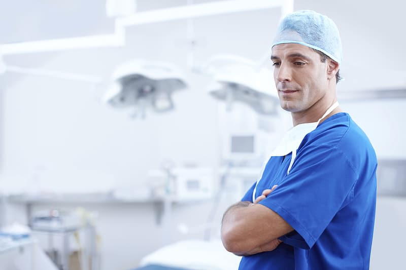 Man wearing blue nursing scrub top
