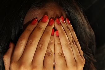 Fingernails with red nail polish