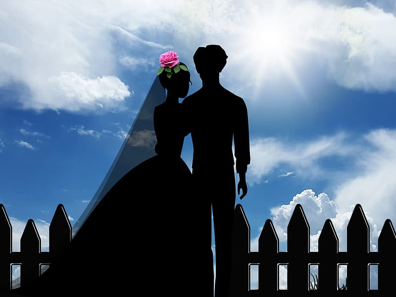 Silhouette of man and woman standing on roof during daytime