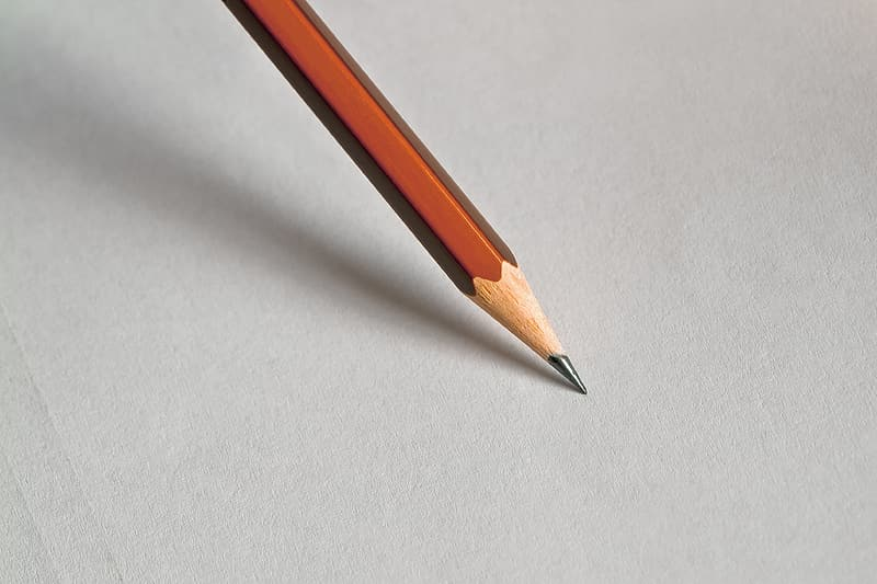 Macro photography of brown pencil tip on white surface