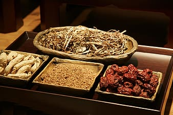 Tray of foods on brown wooden tray