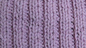 Pink and white knit textile