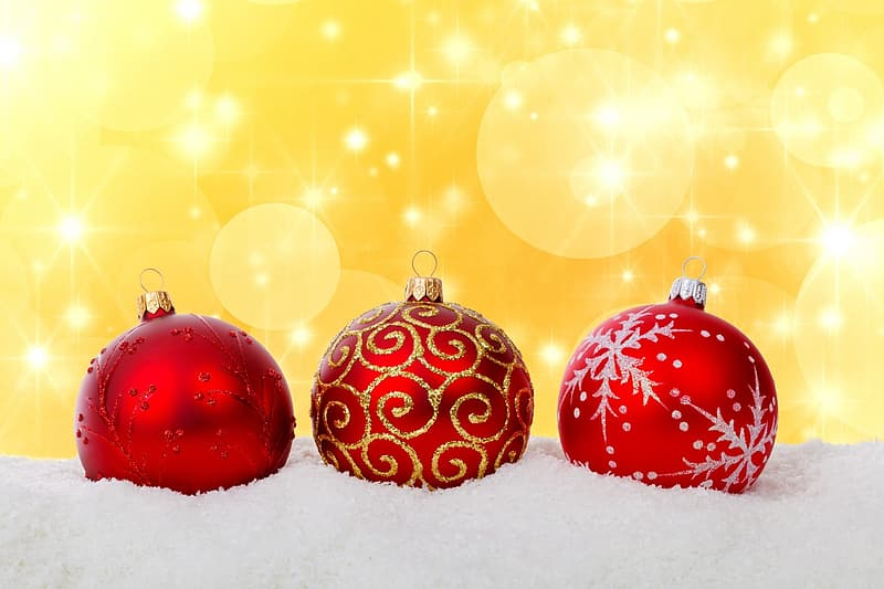 Three red baubles place on white panel with yellow background