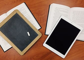 White ipad on white book page