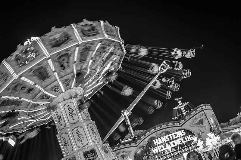 Grayscale photo of carousel with people
