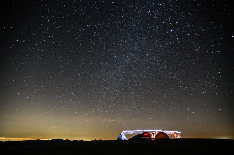 White and brown tent bellow black nightsky