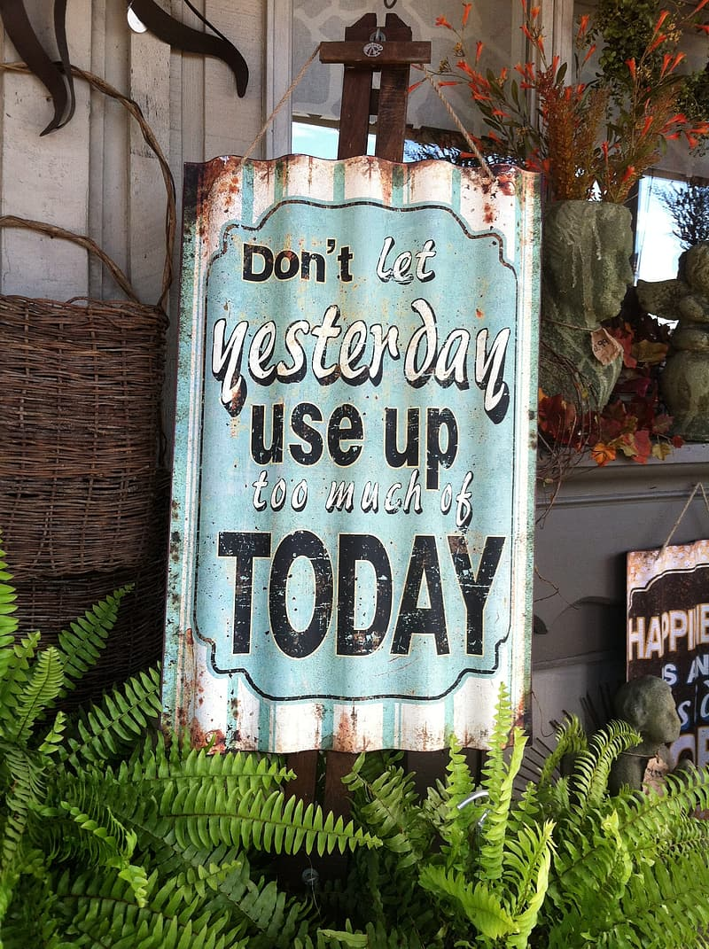 Don't Let Yesterday Use Up Too Much of Today wooden signage