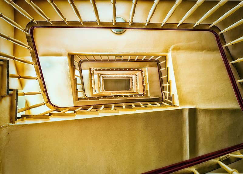 White concrete staircase with gold railings