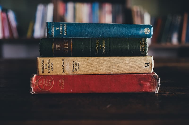 Photo of four assorted-title books