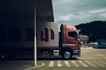 Red and grey truck on road