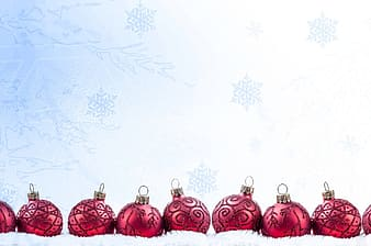 Nine red baubles on white textile