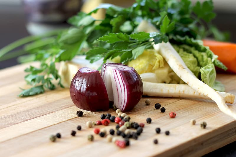 Brown onion and black pepper and green leaf vegetable