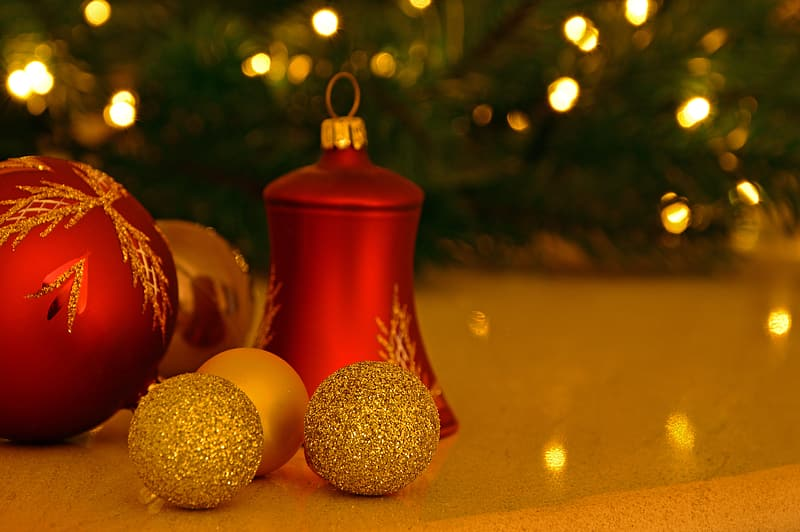 Red and gold baubles on white surface