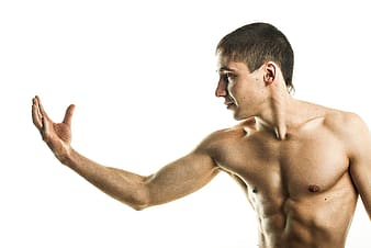Topless man with white background