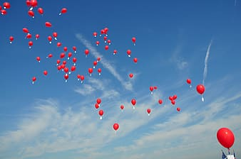 Red balloons on air