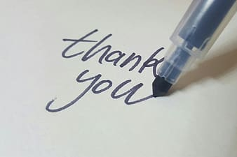 Black pen writing thank you