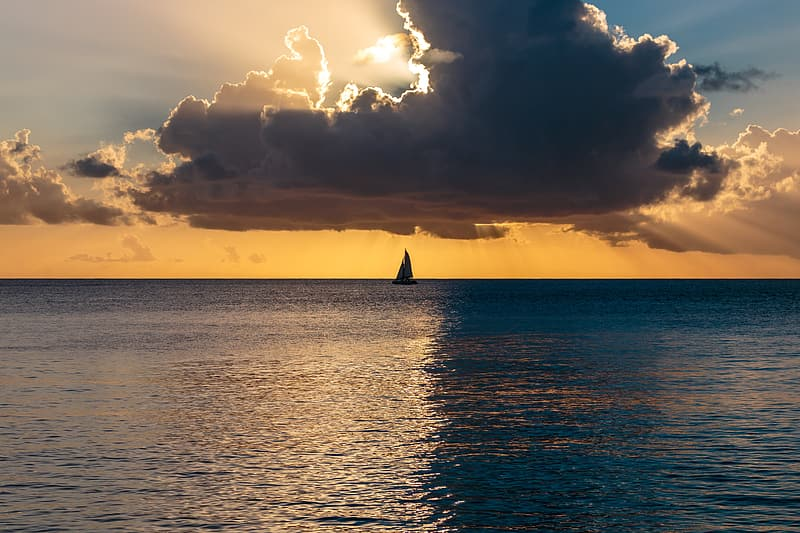 Silhouette of boat on calm body of water