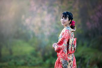Woman wearing pink and green floral kinomo traditional dress