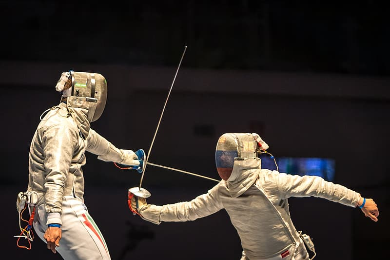 Two person doing fencing sport