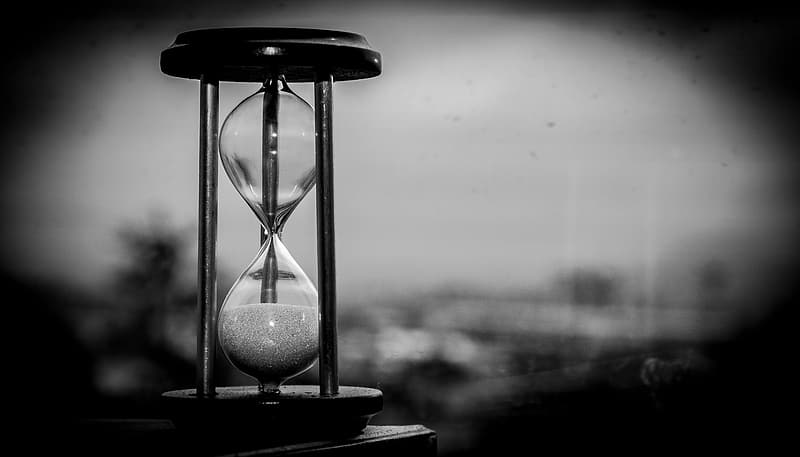 Gray scale photo of sand clock